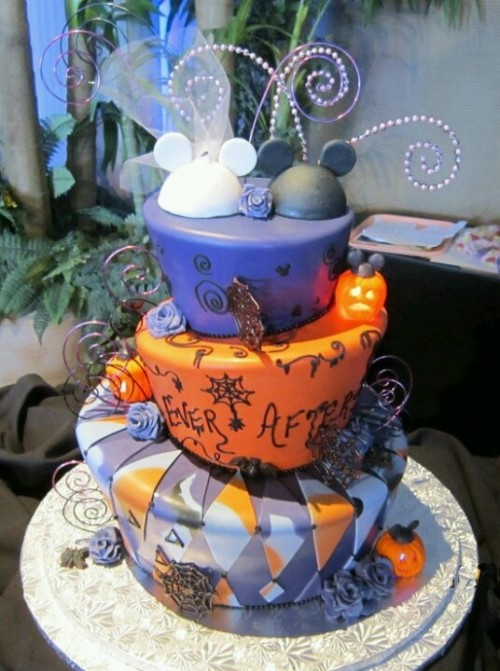 a purple and orange wedding cake with cut tiers, various patterns, letters and monograms, spiderwebs and Mickey Mouse toppers for fun