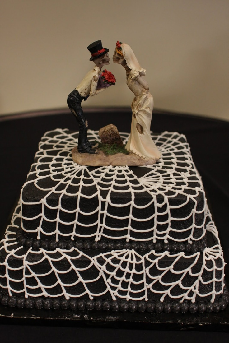 a black and white square spiderweb wedding cake with cool toppers is a stylish and simple idea for a Halloween wedding