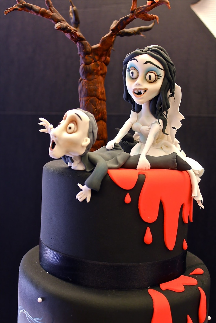 a black wedding cake with blood drips, a scary tree and fun Sally and Jack Skellington toppers for a Halloween wedding
