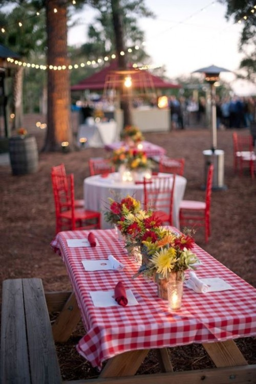 a colorful summer picnic with simple furniture, bright blooms and plaid textiles is a cool idea for a rustic rehearsal