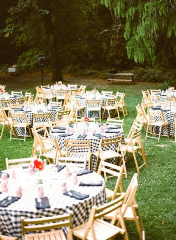 a rustic picnic setting with yellow furniture and plaid textiles, bright blooms for a summer rehearsal
