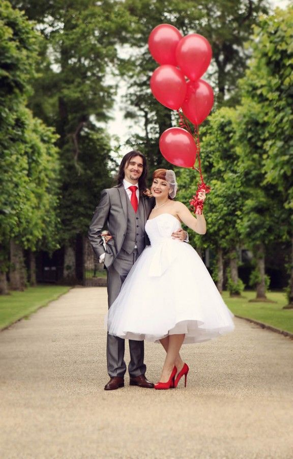 touches of red   red balloons, a red tie and shoes will give a bold touch to your look