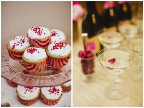 cupcakes with icing and red toppers and striped red and pink liners, drinks with berries