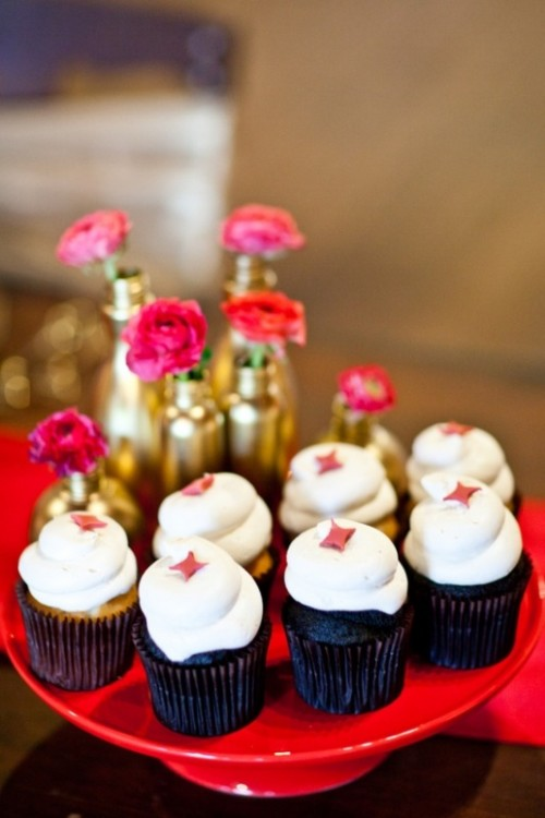 chocolate cupcakes with icing and pink touches, gold vases with pink blooms to highlight the color scheme