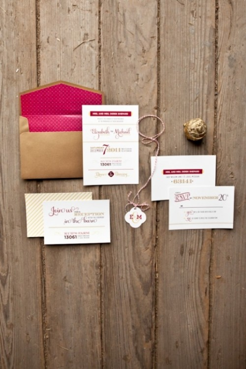 a stylish wedding invitation suite with a gold envelope and pink lining and invites done in pink, red and gold