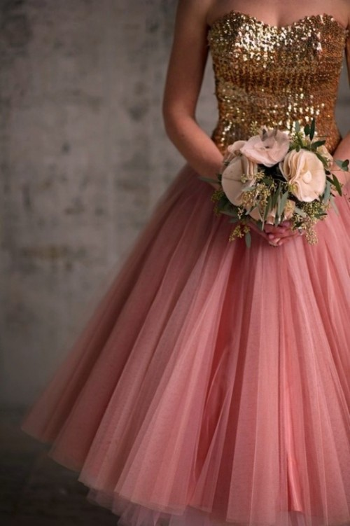 a strapless wedding dress with a gold sequin bodice and a pink tulle midi skirt for a touch of glam at the wedding