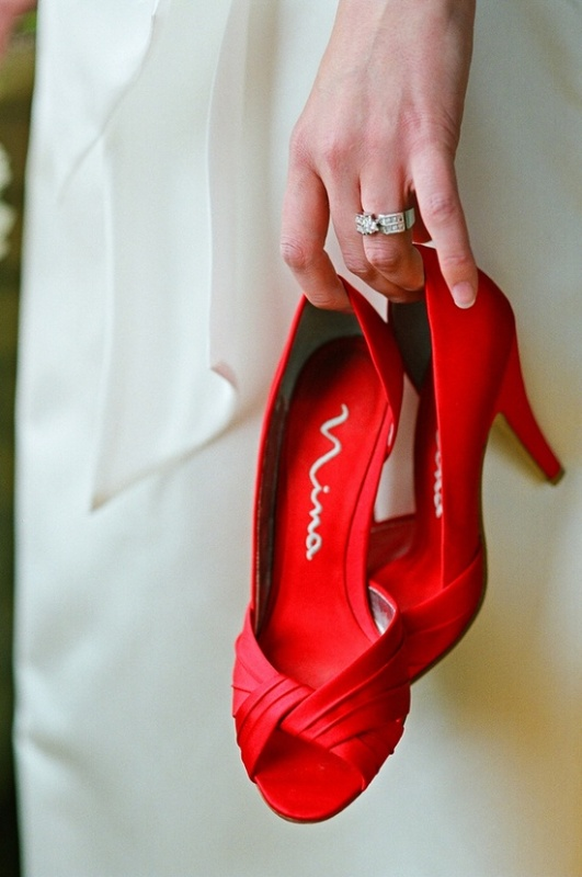 a pair of vintage red peep toe heels is a timeless idea for many brides, and cna be used at such a wedding, too