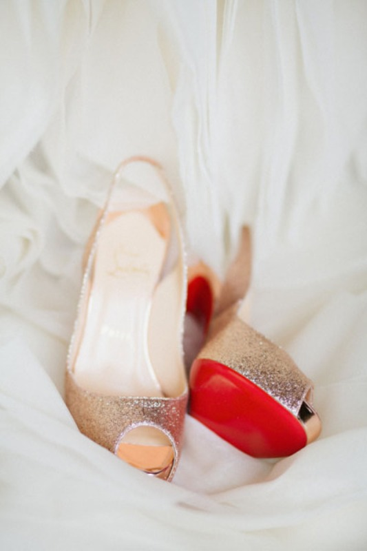 gold wedding shoes with red bottoms are great to match the color scheme