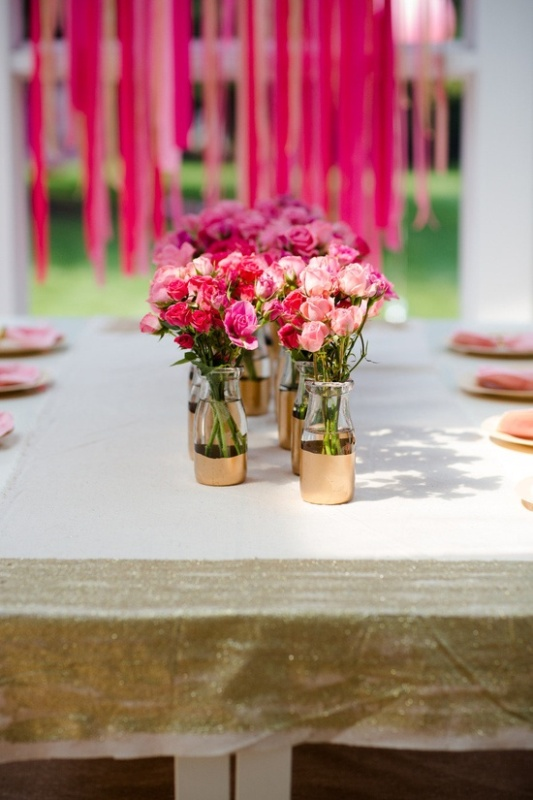 pink, red and blush blooms in bottles with touches of gold are simple and cute wedding centerpieces