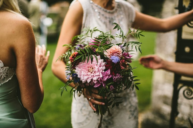 Picture Of relaxed and colorful wedding inspiration filled with flowers  10