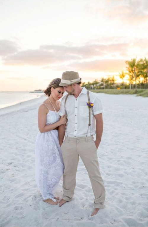 a boho beach maxi wedding dress with paghetti straps, a necklace of shells and a braided hairstyle