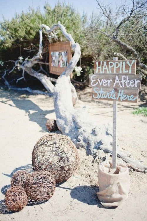 vine balls, driftwood, simple wooden signs and family photos on the tree