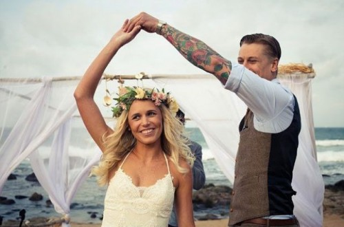 a boho lace wedding dress with spaghetti straps and a floral crown are a great idea for a boho chic wedding