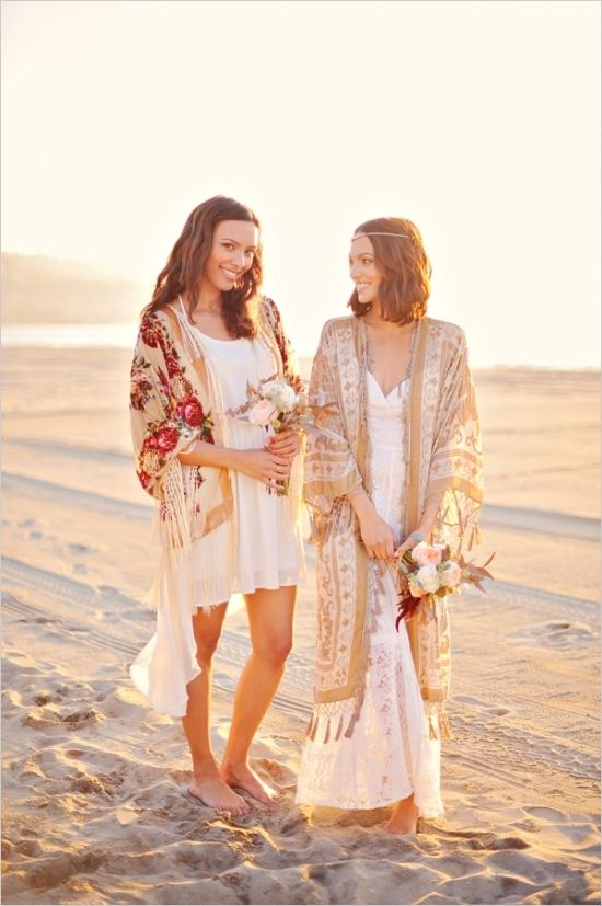 boho beach brides wearing simple white wedding dresses and colorful and neutral tassel kimonos plus a chain