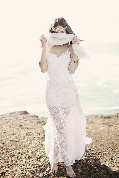 a boho lace wedding dress with spaghetti straps and an illusion skirt, a chain hairpiece are great for a beach boho bride