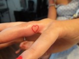 a little red heart tattoo on the side of your ring finger will be a romantic solution instead of your wedding ring
