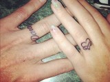 a lovely wrapped heart-shaped tattoo on the ring finger is a bold and cool idea to substitute a usual wedding ring