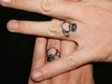 hearts with crowns tattoos on the ring fingers are amazing for rocking them instead of usual wedding rings
