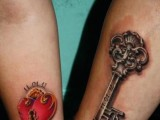 large colorful heart lock and vintage key tattoos with the wedding date on the arms are amazing to memorize your wedding date