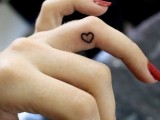 a small heart-shaped tattoo on the side of your ring finger is a pretty and romantic idea to rock