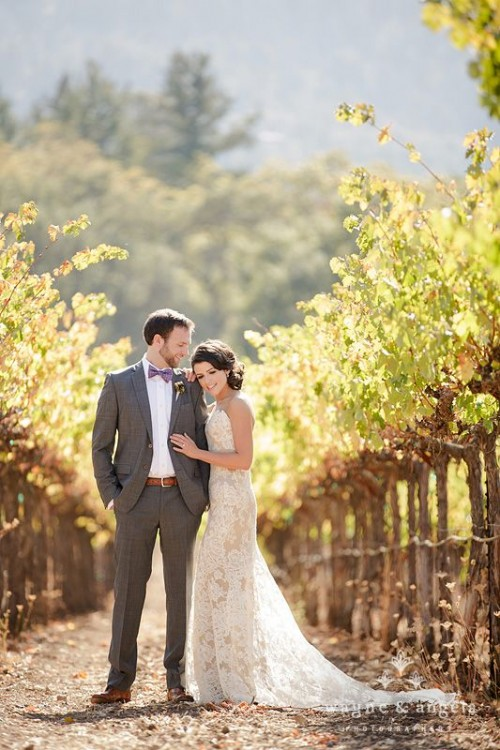 a strapless lace sheath wedding dress with a train is a chic and romantic idea to pull off at a vineyard wedding