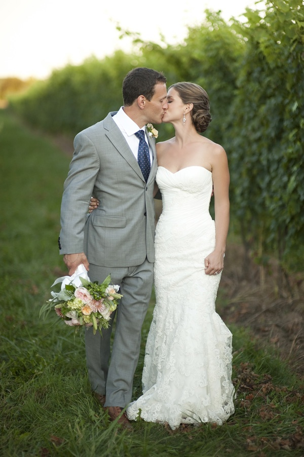 a strapless sheath wedding dress with a draped bodice and a lace skirt is a stylish and chic idea