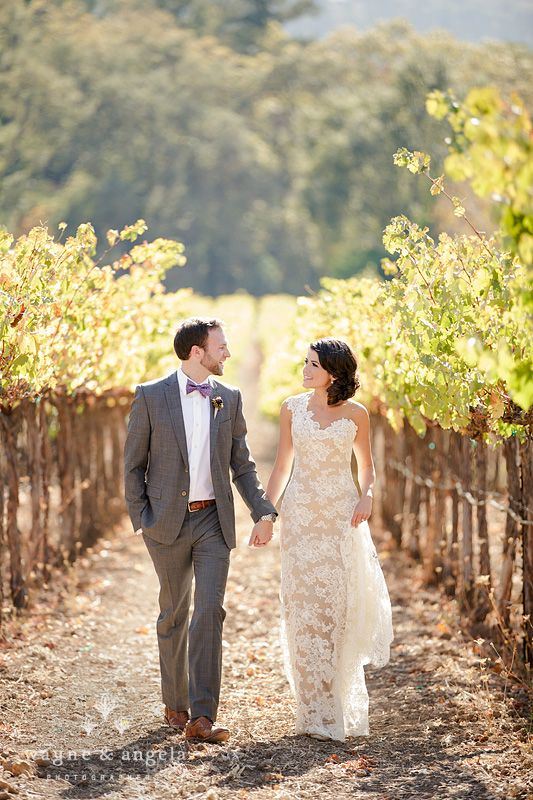 a one shoulder lace sheath wedding dress with a long train is a chic idea that is comfy to wear