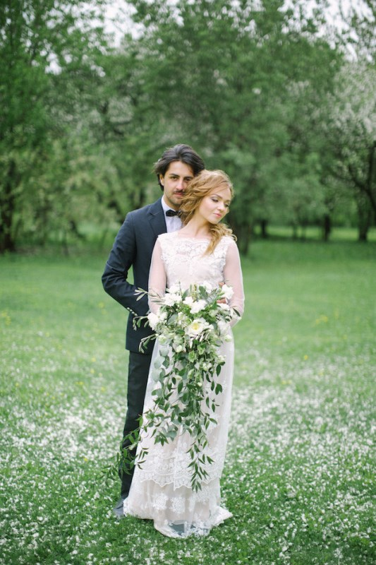 Picture Of romantic white wedding inspirational shoot in a blossoming garden  13