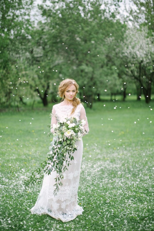 Picture Of romantic white wedding inspirational shoot in a blossoming garden  5