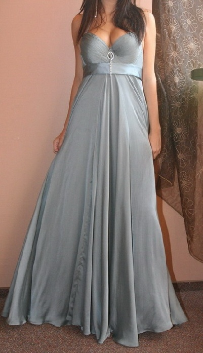 a silver maxi bridesmaid dress with a depe neckline and an embellished neckline for a sexy look