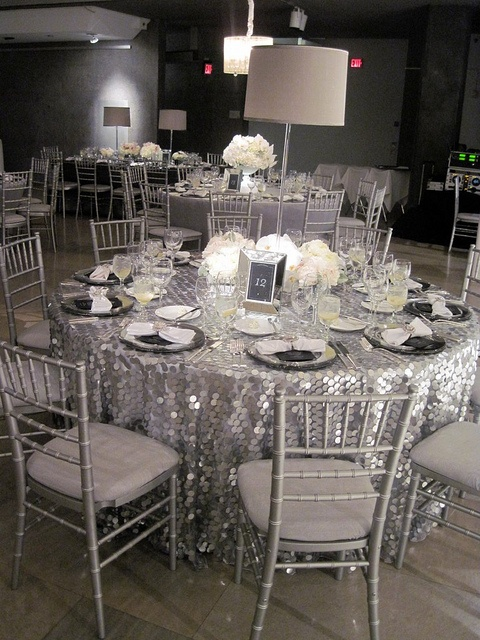 large silver sequin tablecloths and white floral centerpieces will create a cool frozen winter ambience