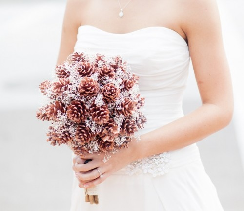 a pinecone wedding bouquet with silver touches is a cool idea of a non-traditional arrangement to rock