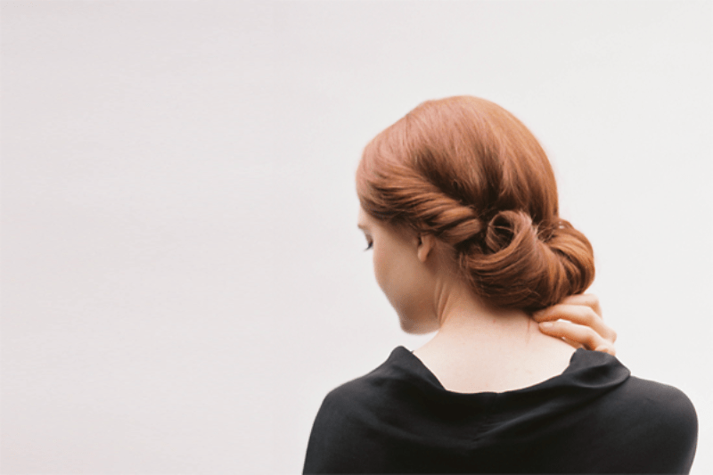 Picture Of simple yet elegant diy rolled chignon wedding hairstyle  1