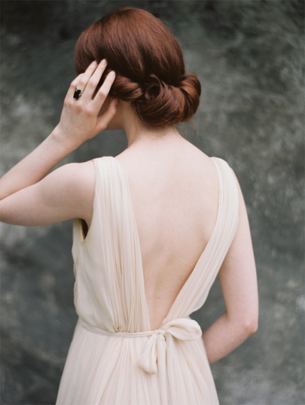 Picture Of simple yet elegant diy rolled chignon wedding hairstyle  2