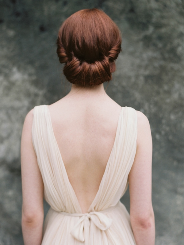 Picture Of simple yet elegant diy rolled chignon wedding hairstyle  3