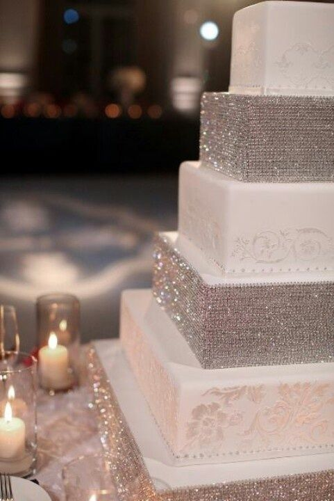 a super glam square wedding cake with white patterned and silver glitter tiers is very chic and very fun