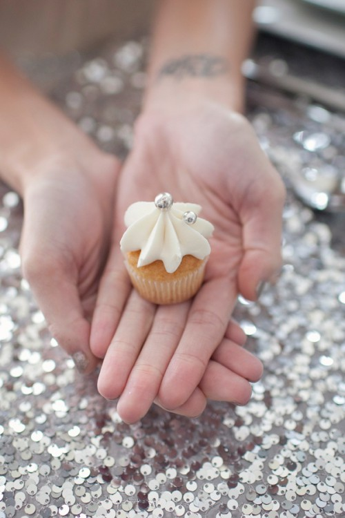 a mini cupcake with silver edible beads is a cool confection piece for a glam or NYE wedding