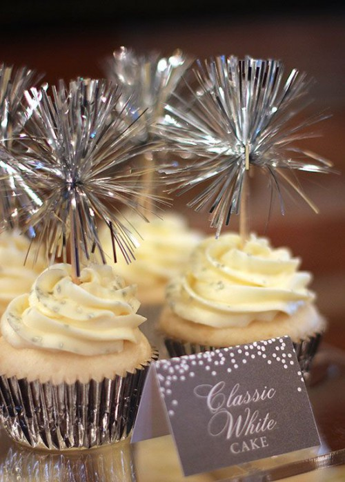 cupcakes in metallic liners and with shiny and fun toppers for a NYE wedding