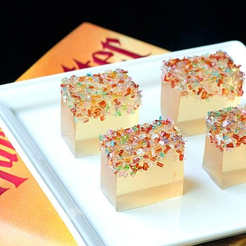 jello shots topped with colorful confetti are tasty and fun desserts for a NYE wedding