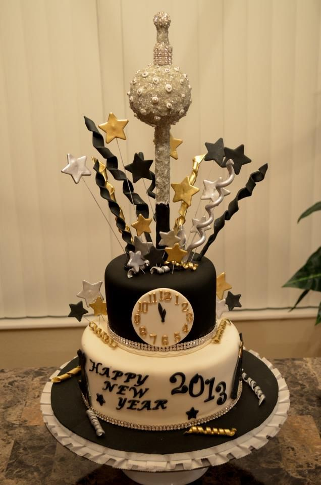 a black and white wedding cake with a clock, stars, letters and a crazy star cake topper to inspire partying all night long