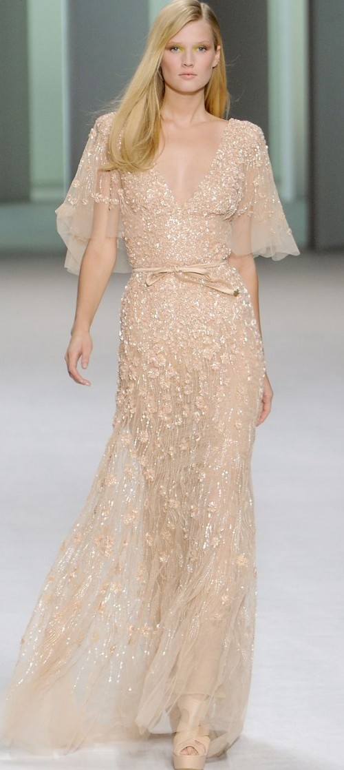 a peachy embellished sheath wedding dress with floral appliques, wide sleeves and a deep V-neckline