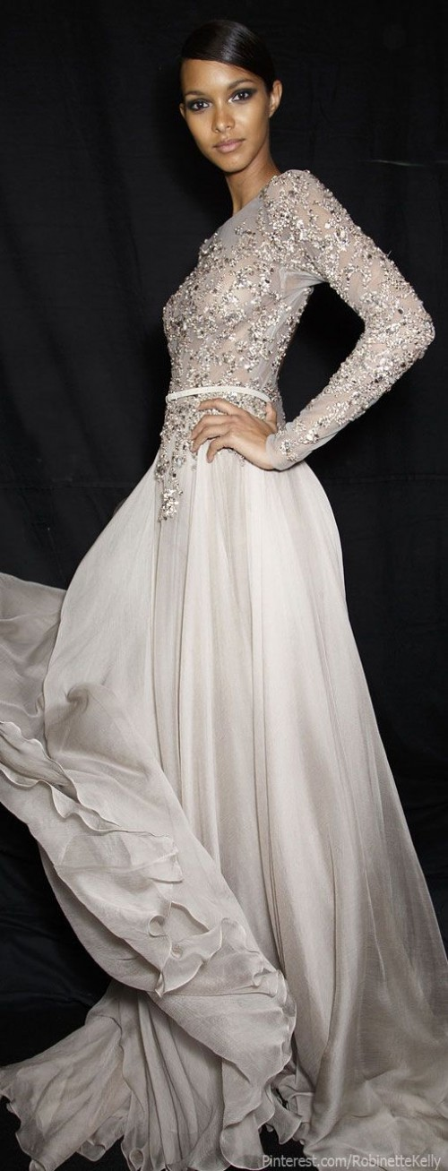 a dove grey wedding dress with an embellished bodice, long sleeves, a high neckline and a plain skirt is very refined and chic