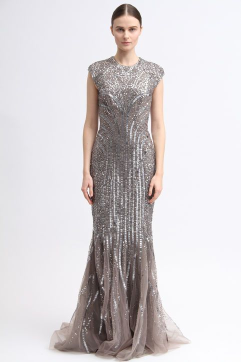 a taupe sheath wedding dress with silver sequins all over, cap sleeves, a high neckline and a small train makes a statement with its color