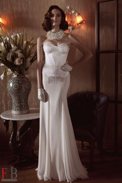 a sexy and elegant strapless sheath wedding dress with a corset top, lace, a statement necklace and gloves