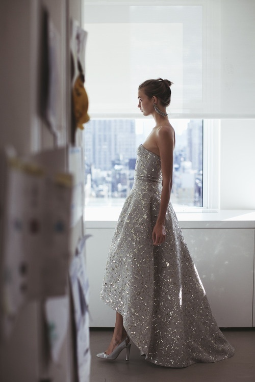 a silver fully embellished strapless wedding ballgown with a high low skirt and a sash just wows with its look
