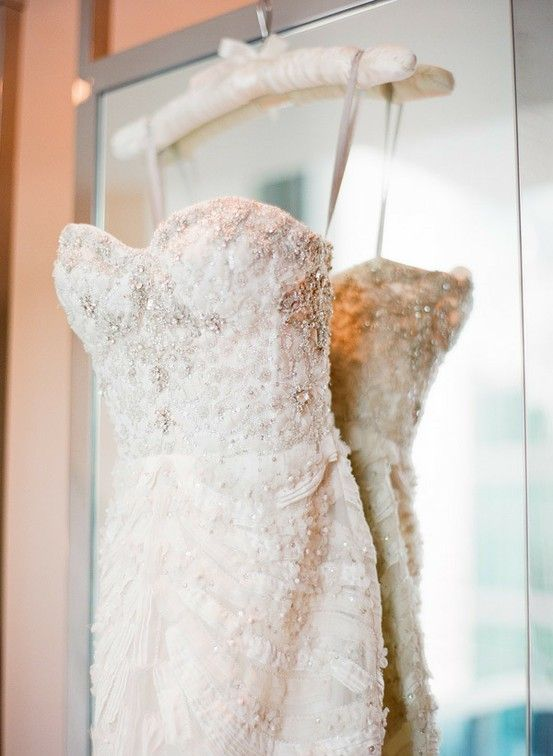 a beautiful ivory strapless embellished sheath wedding dress is a glam and chic idea to rock