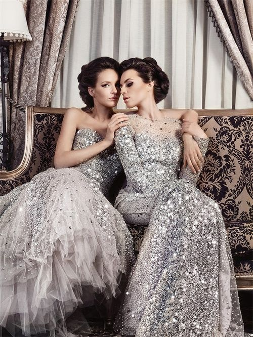 sparkling silver wedding dresses - a strapless one with a full skirt and a sheath one with long sleeves and an illusion neckline