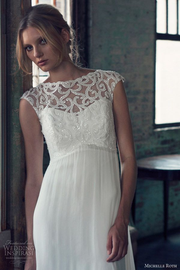 a white sheath wedding dress with an illusion neckline, cap sleeves and embellishments on the bodice