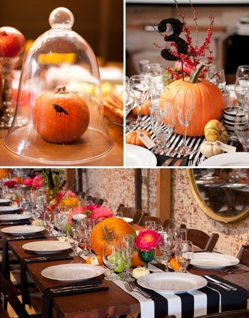 a stylish and bold Halloween wedding tablescape with a striped table runner, pumpkins, a glitter table number and some branches plus bright blooms
