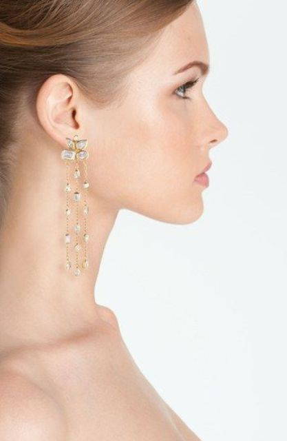 Picture Of statement earrings wedding trend ideas  15